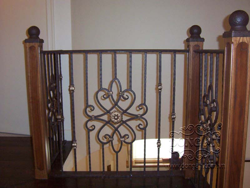 Cầu thang sắt nghệ thuật tay vịn gỗ 15